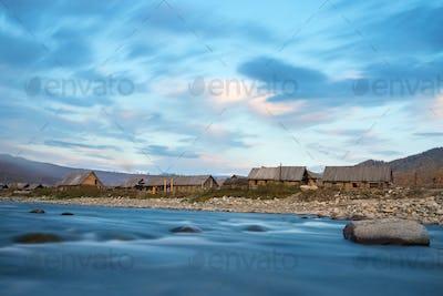 log cabin on hemu riverside, beautiful xinjiang kanas villages in sunset