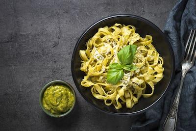 Tagliatelle pasta with pesto sauce and parmesan