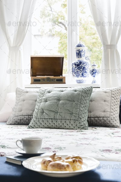 Close-up of a sweet breakfast on a bed in a stylish bedroom inte