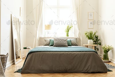 Beige, green and gray bedroom interior in a tenement house with