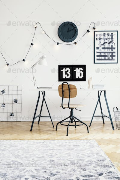 Industrial chair and desk with a computer in a study space of a