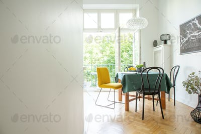 Dining room interior with wooden furniture,white walls, copy spa