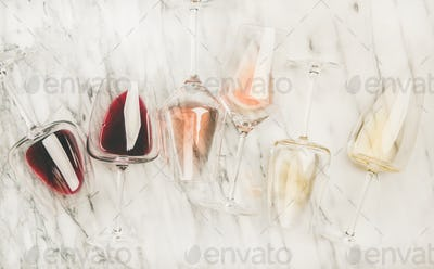 Red, rose, white wine in glasses and corkscrews