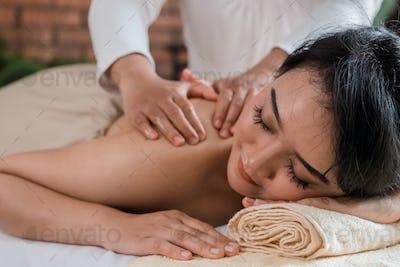 asian young girl having massage