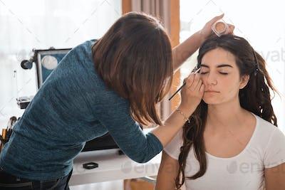 make up artist applying eyebrow to be carefully