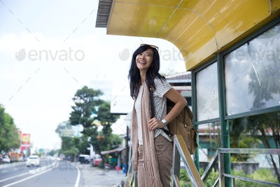 Asian woman standing enjoyed waiting bus
