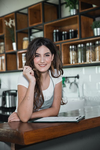 owner of a cafe or waitress smiling