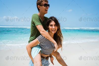 woman carrying their man on their back
