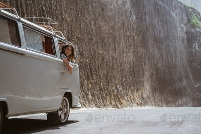 happy young woman ride car on road trip
