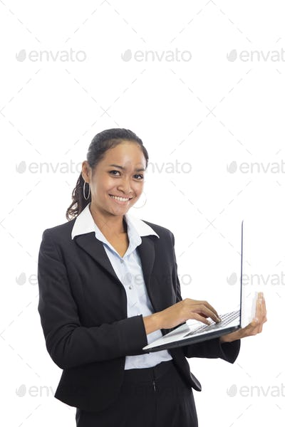 young business woman working on her laptop while standing