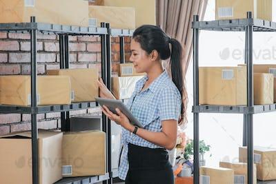 asian online seller using tablet pc