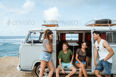 happy hipster enjoy holiday while leaning at their vintage van