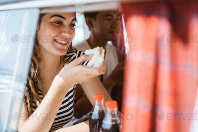 young woman sitting enjoy a sandwich breakfast