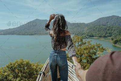 woman with beautiful view from the top of the mountain