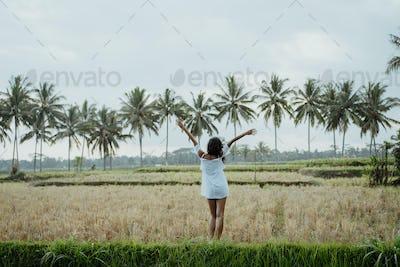 woman in white enjoy in rice field terrace