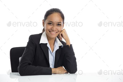 young business woman sitting on her workspace