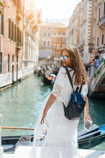 Young girl posing on camera in venetian streets