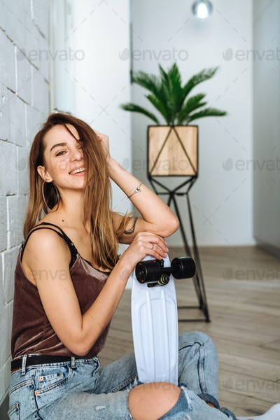 Cute, attractive woman with skateboard