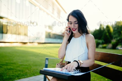 Woman studying on bench