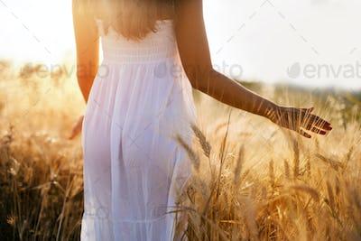 Beautiful woman in barley field