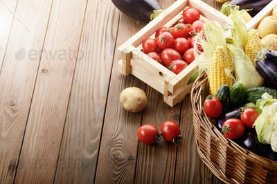 Basket of Organic Vegetable Food Ingredients and crates of potat