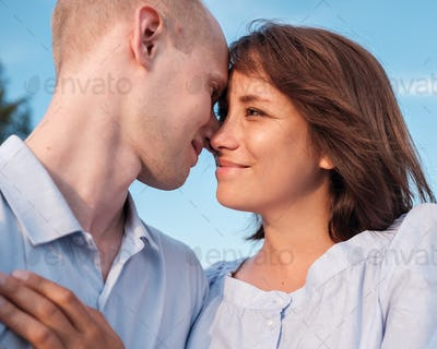 Young couple  looking on each other with love.