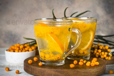 Sea buckthorn tea with orange in a glass cups