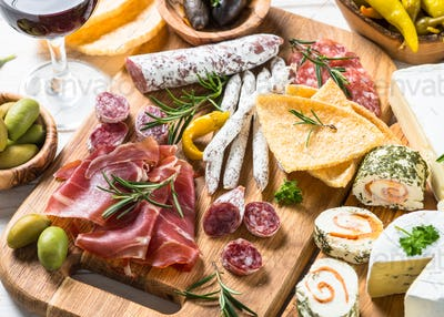 Antipasto delicatessen - meat, cheese and wine