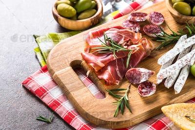 Antipasto delicatessen - sliced meat, ham, salami and olives on