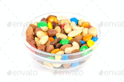 Trail mix in glass bowl over white