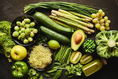 Green healthy food composition with avocado, broccoli, apple, smoothie...