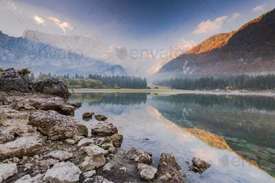 Cold and foggy sunrise over Fusine Lakes in Italy