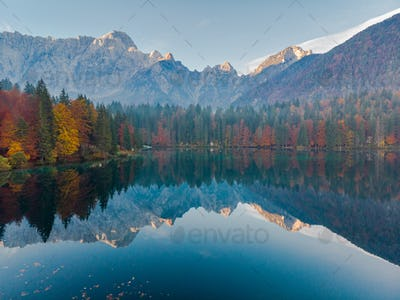 Panoramic view at sunrise over alpine lake in Italy