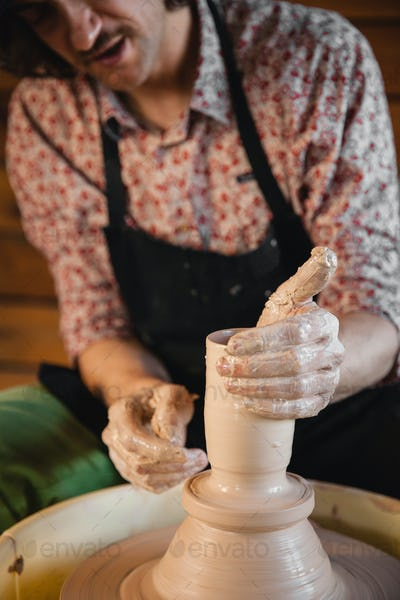 Potter master creating new ceramic pot