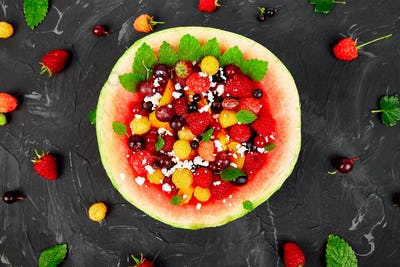 Watermelon bowl with cottage cheese and berries