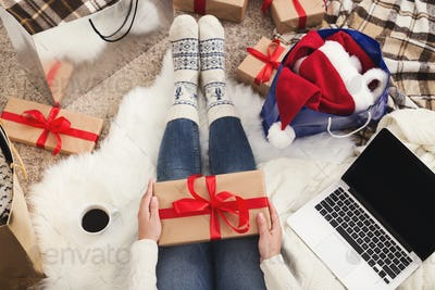 Woman get presents. Girl holding a Christmas gift