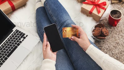 Christmas online shopping. Woman ordering gifts with smartphone