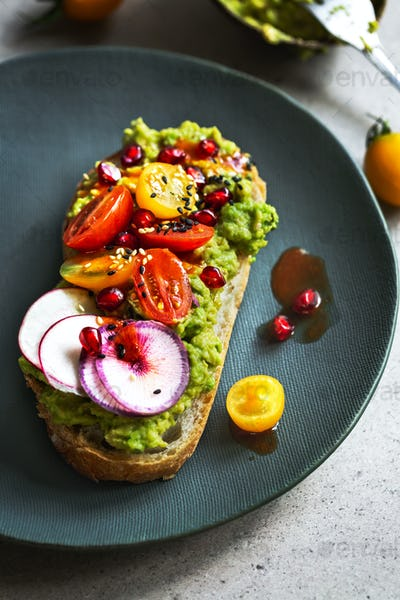 Avocado with Tomato , Pomegranate,Radish on toast