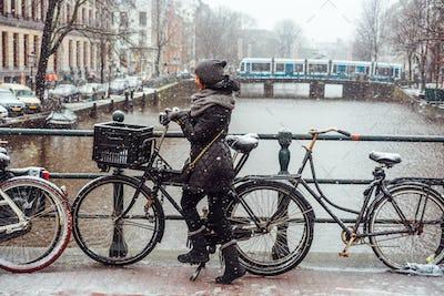 Girl on a bicycle on the bridge