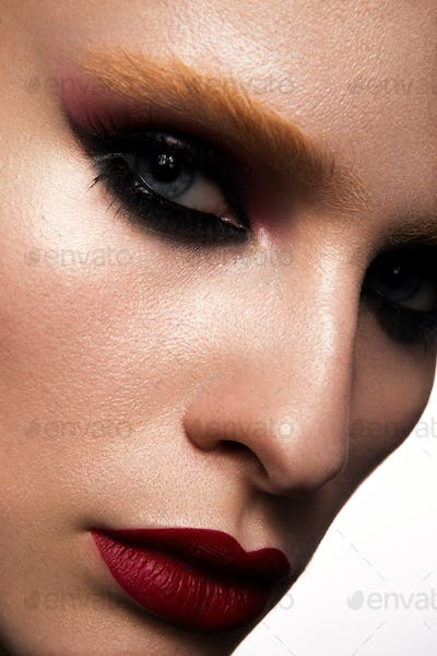 Beautiful woman with professional make up. Red lips