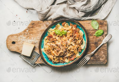 Italian traditional pasta dinner with tagliatelle bolognese, horizontal composition