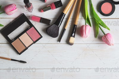 Woman cosmetics, brush and make up on white wooden background, Top view