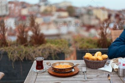 Breakfast on the veranda in the background city view