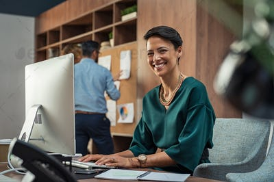 Young businesswoman smiling at office