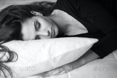 Woman sleeping on the bed