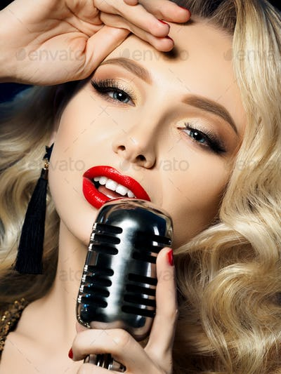 Portrait of beautiful blond female singer