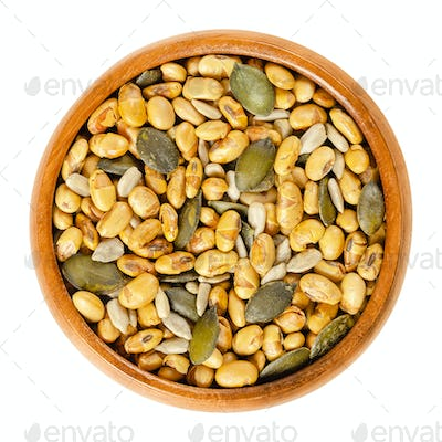 Snack mix. Soybeans, pumpkin and sunflower seeds in wooden bowl