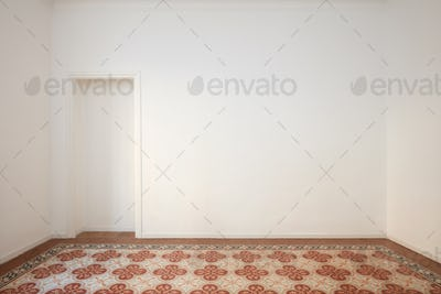 Blank, white wall with niche and decorated tiled floor