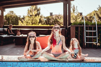 Mom and two daughters doing yoga, outdoor