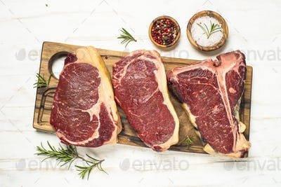 Raw meat beef steak on white top view